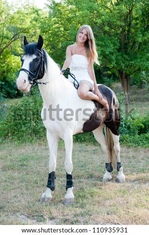 woman with a horse outdoor - stock photo