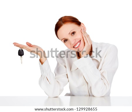 Woman with a key smiling to you - stock photo