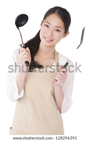 Woman with a ladle and spatula - stock photo