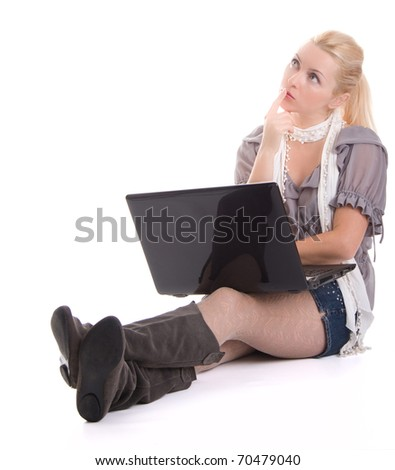 Woman with a laptop computer thinking isolated on white background - stock photo
