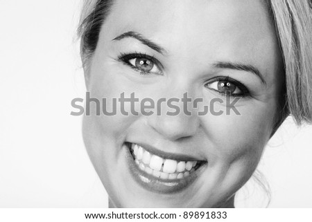 woman with a large box of chocolate and she just eaten one she does not like - stock photo