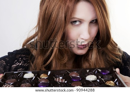 woman with a large box of chocolates