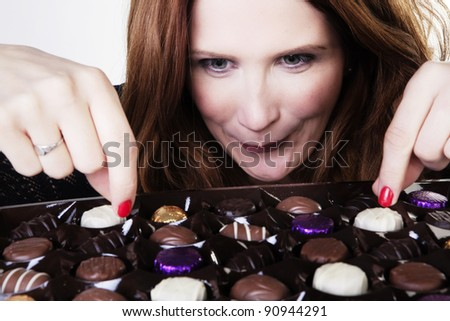 woman with a large box of chocolates - stock photo