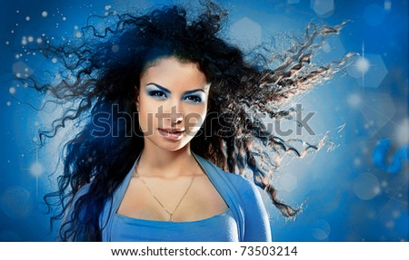 Woman with a long beautiful hair on blue background - stock photo