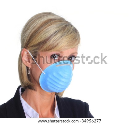 Woman with a mask as protection again the influenza virus. - stock photo