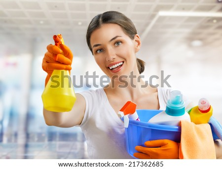 Woman with a pack of detergents - stock photo