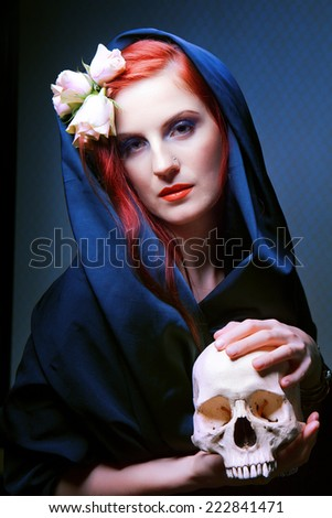 Woman with a pale face and skull. skull