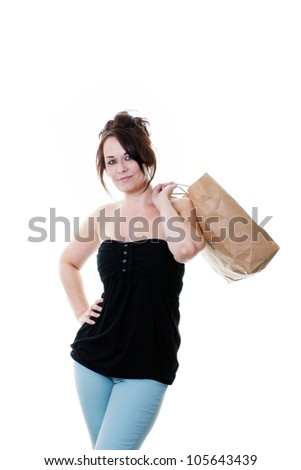 woman with a paper shopping bag isolated on white