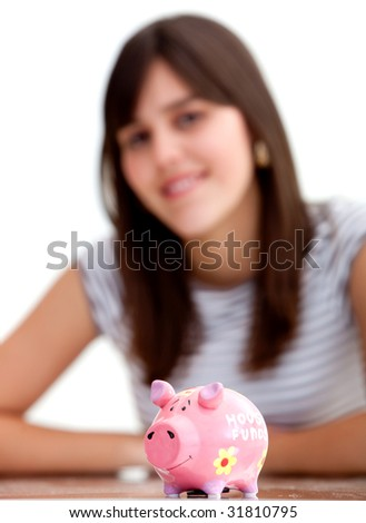 Woman with a piggy bank isolated over white