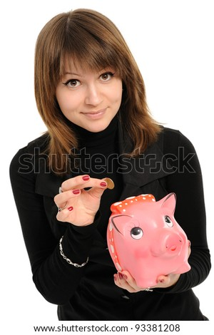 woman with a piggybank isolated on white background - stock photo