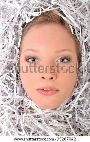 woman with a pile of shredded paper