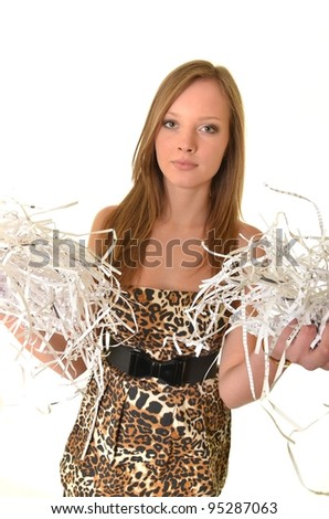 woman with a pile of shredded paper - stock photo