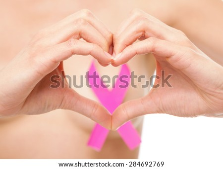 Woman with a pink breast cancer awareness ribbon - stock photo