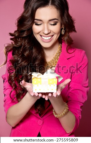 Woman with a present. Happy girl with a gift. - stock photo