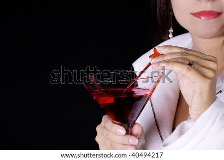 Woman with a red cocktail wearing a white coat