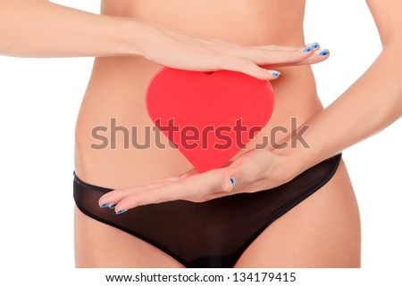 Woman with a red heart - stock photo
