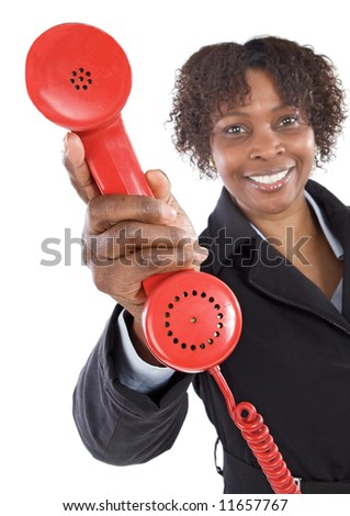 Woman with a red phone a over white background - stock photo