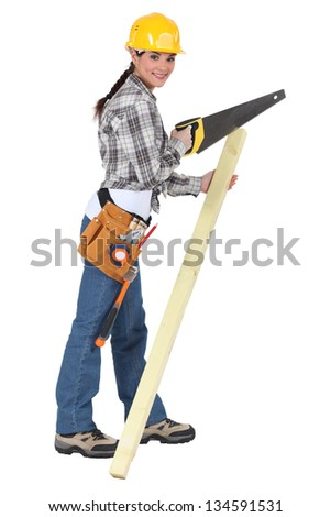 Woman with a saw and timber - stock photo