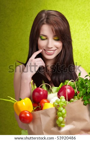 Woman with a shopping bag filled with nutritious fruit and vegetables