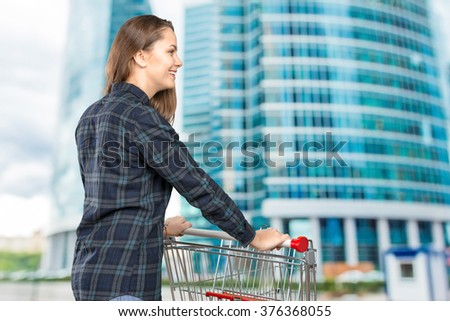Woman with a shopping cart