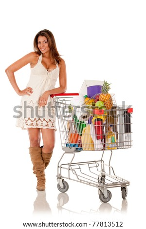 Woman with a shopping cart buying groceries - isolated over white - stock photo