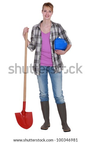 Woman with a shovel - stock photo