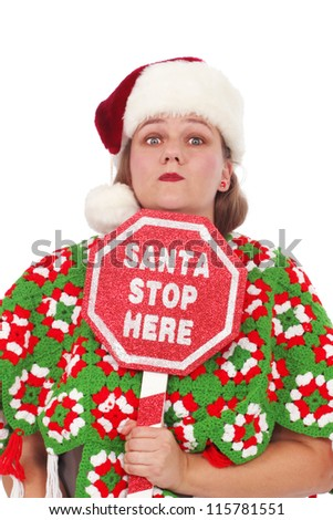 Woman with a sign Santa Stop Here - stock photo