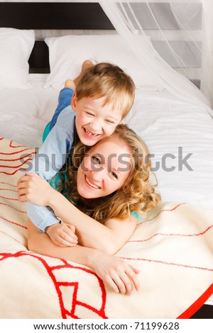 woman with a son on a bed