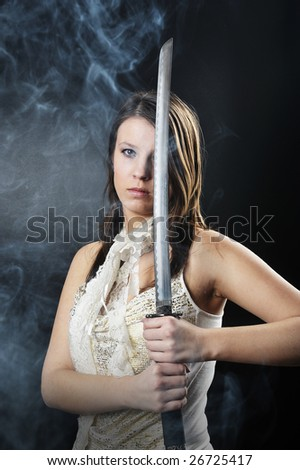 woman with a sword isolated on black background - stock photo