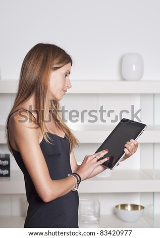 Woman with a tablet - stock photo