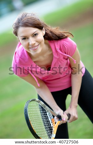 Woman with a tennis racket on her hands - stock photo