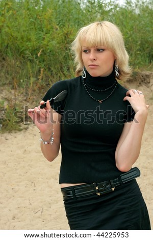 woman with a throwing knife - stock photo