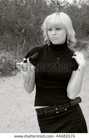 woman with a throwing knife, B&W - stock photo