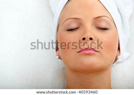 woman with a towel on her head - beauty concepts - stock photo