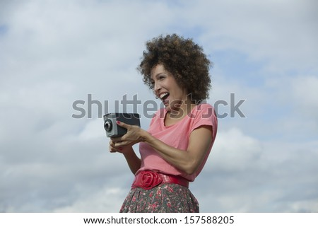 Woman with a vintage camera  - stock photo