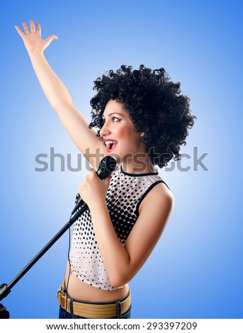 Woman with afro haircut against gradient  - stock photo