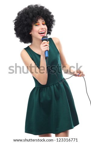 Woman with afro hairstyle doing karaoke - stock photo