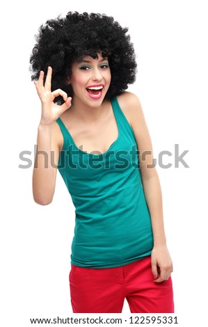 Woman with afro showing OK sign - stock photo