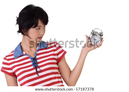 Woman with alarm clock, closeup portrait on white background. - stock photo