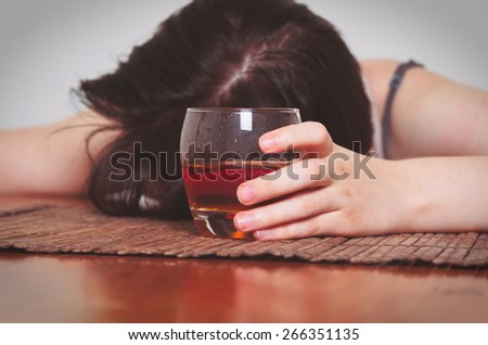 woman with alcohol addiction concept,shallow DOF - stock photo
