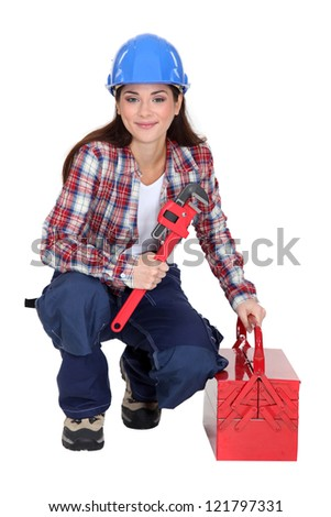 Woman with an adjustable wrench - stock photo