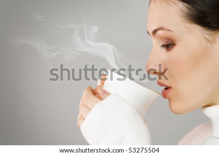 Woman with an aromatic coffee in hands - stock photo