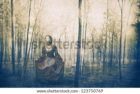 Woman with an historic costume in a wood