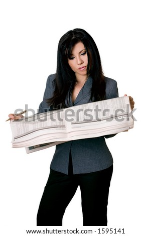 Woman with an open newspaper on white background. - stock photo