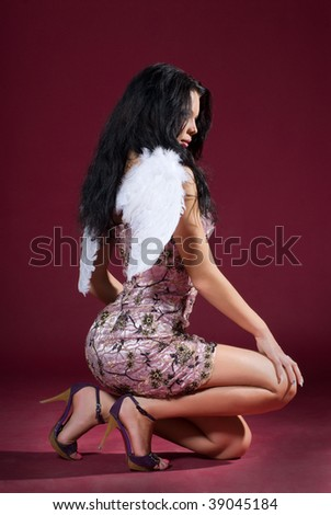 woman with angelic wings - stock photo