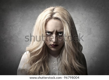Woman with angry expression - stock photo