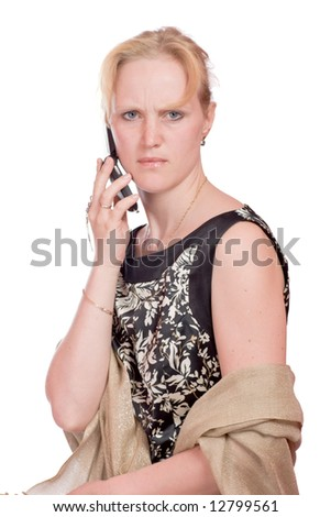 Woman with angry look talking on mobile phone isolated on white - stock photo