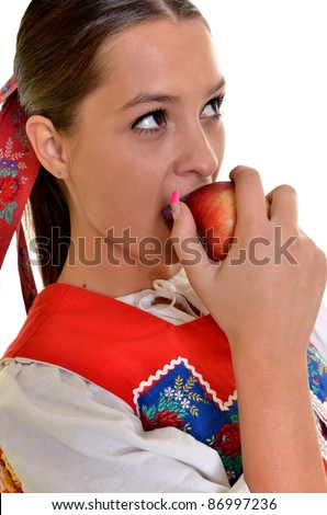 woman with apples in national slovakian dress