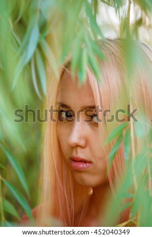 Woman with Asian appearance is resting in the Park  - stock photo