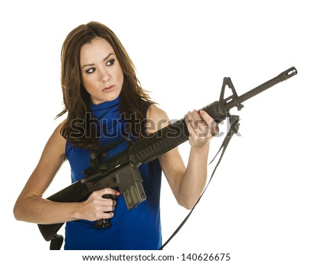 Woman with assault rifle on white background - stock photo